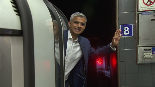 interior shots sadiq khan london mayor waving from drivers cab of a london underground train on first night of the 24 hour night tube service on... - sadiq khan stock videos & royalty-free footage