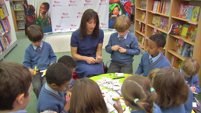 interior shots samantha cameron wife of prime minister david cameron sits interacts with young primary school children at a save the children event... - save the children stock videos & royalty-free footage