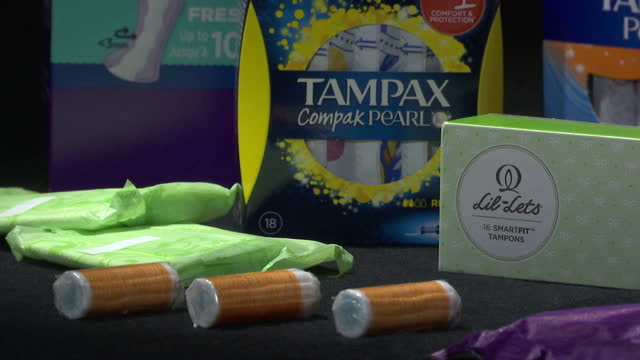 interior shots sanitary products tampons sanitary towels and pantyliners laid out on display on table in dark room always tampax lil lets carefree... - tampon stock videos & royalty-free footage