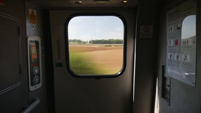 Interior shots scenic views out of window on board Virgin Train as it passes through countryside on August 24 2016 in London England