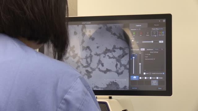 interior shots scientist working on coronavirus vaccine in laboratory in oxford on 23 april 2020 in oxford, united kingdom. - research video stock e b–roll