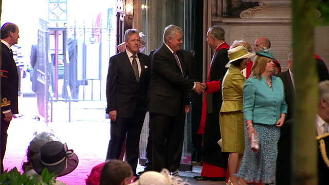 interior shots scottish first minister alex salmond first minister of northern ireland peter robinson enter westminster abbey greet members of the... - minister clergy stock videos and b-roll footage