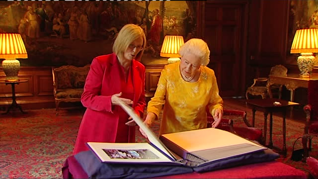 interior shots scottish parliament presiding officer tricia marwick msp shows the queen a book of photographs of her majesty's visits to the scottish... - the queen stock videos and b-roll footage