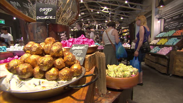 interior shots shoppers browsing cosmetic products on display in lush store. on august 24, 2016 in london, england. - lush stock videos & royalty-free footage