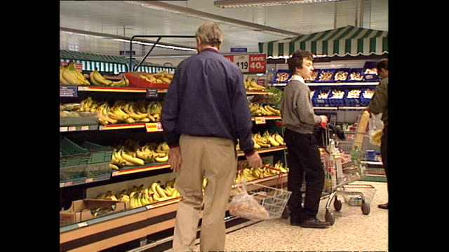 interior shots shoppers browsing food items in the fruit and vegetable section of tesco supermarket on april 10 1995 in london england - tesco点の映像素材/bロール