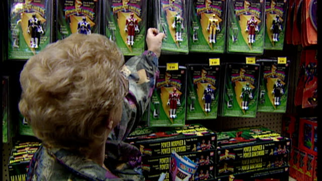 Interior shots shoppers head straight to the Power Rangers aisle to select toys to buy Power Rangers toys on shelves the 1994 Christmas craze toy on...