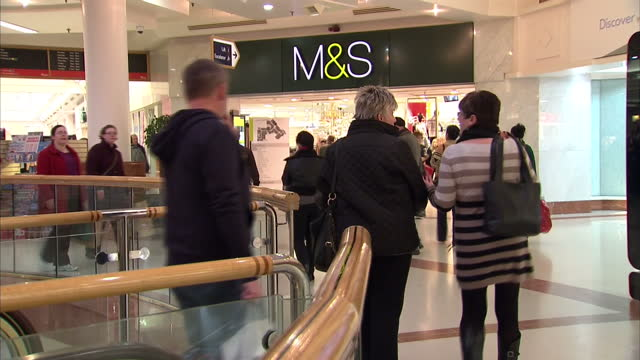 interior shots shoppers milling around entrance to marks and spencer ms store in merry hill westfield shopping centre post christmas sales shopping... - west midlands stock-videos und b-roll-filmmaterial