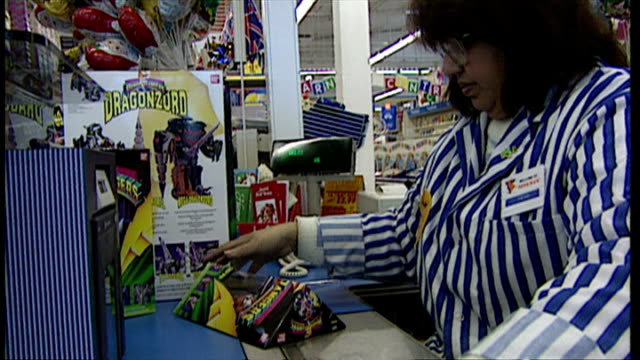 Interior shots shoppers paying for Power Rangers toys at checkouts in Toys R Us store Power Rangers toys the 1994 Christmas craze toy on December 07...