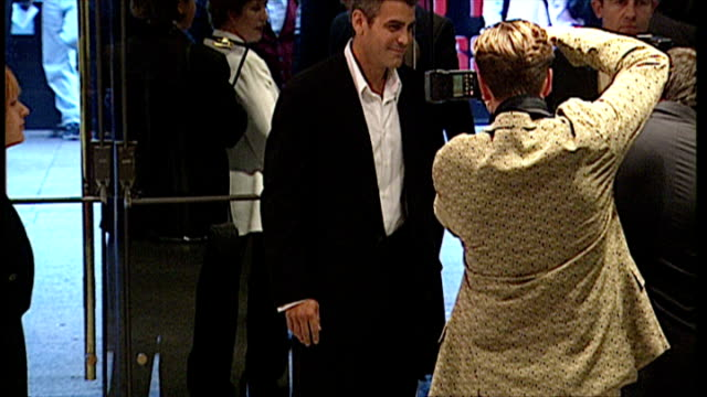 Interior shots showing actor George Clooney arriving at premiere of Mission Impossible on July 4 1996 in London United Kingdom