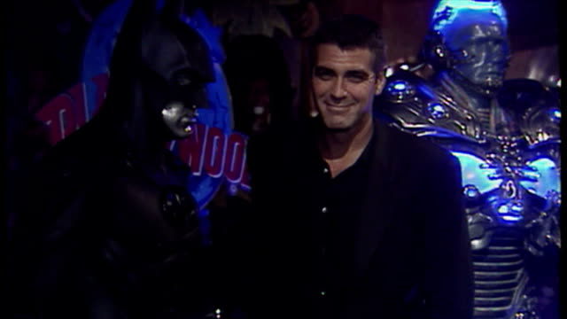 Interior shots showing actor George Clooney posing next to Batman costume at Planet Hollywood London to promote 'Batman and Robin' movie on June 23...