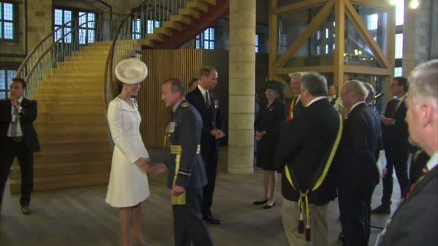 interior shots showing british royals catherine, duchess of cambridge and prince william, duke of cambridge entering cloth hall ahead of belgian... - battaglia video stock e b–roll