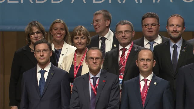 Interior shots showing world Foreign Ministers posing for NATO family photo incl John Kerry United States Secretary of State and Philip Hammond...
