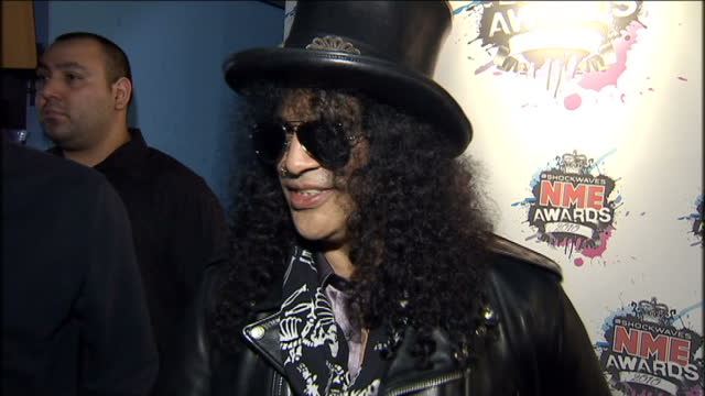 Interior shots Slash from Guns n Roses being interviewed on red carpet at NME Awards