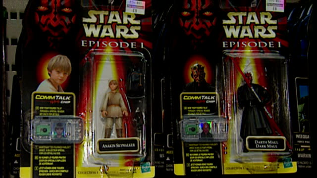 interior shots star wars merchandise and toys on shelves in toy shop includes collectible figures of star wars characters darth maul quigon jinn and... - star wars stock videos & royalty-free footage