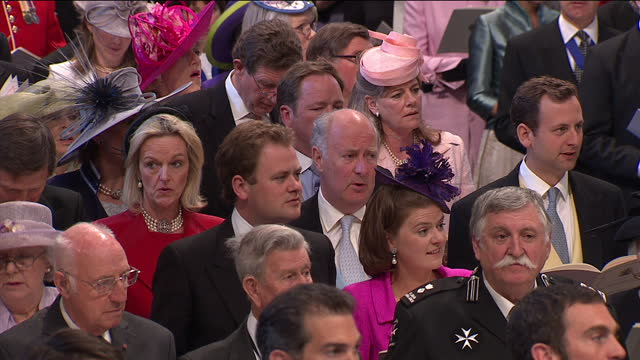"""interior shots the first hymn """"redeemer"""" being sung by the wedding congregation including the queen & prince philip. interior shots prince william &... - 式典点の映像素材/bロール"""