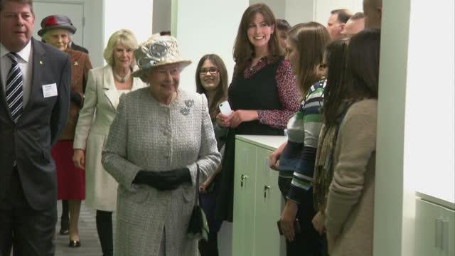 vídeos de stock, filmes e b-roll de interior shots the queen applauded as she walks down corridor in new barnado's hq the queen applauded in barnados hq on december 10, 2013 in ilford,... - ilford