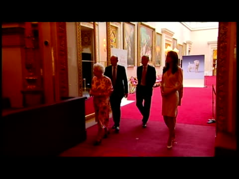 interior shots the queen & catherine, duchess of cambridge walk with aides into exhibition room & view the wedding dress on display the queen &... - assistant stock videos & royalty-free footage