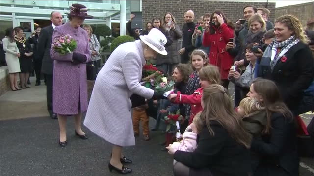 interior shots the queen chats to various people durong her tour of poppy factory exterior shots the queen exits the factory greets well wishers... - richmond upon thames stock-videos und b-roll-filmmaterial