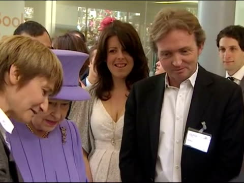 interior shots the queen dressed in purple chats with officials during a tour of exeter queen elizabeth ii diamond jubilee coverage on may 02, 2012... - exeter england stock videos & royalty-free footage