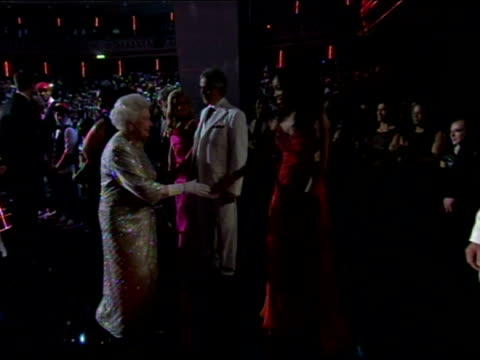 Interior shots the Queen greets various celebrities in line including Placido Domingo Andrea Bocelli Rod Stewart Neil Diamond Kylie Minogue The Queen...