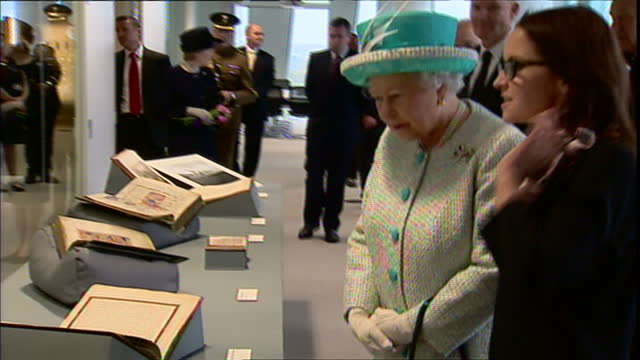 interior shots the queen looks at various old library books on display. interior shots prince philip, duke of edinburgh looking at the books on... - aberdeen schottland stock-videos und b-roll-filmmaterial