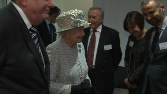 vídeos de stock, filmes e b-roll de interior shots the queen meeting barnado's workers. the queen meeting employees on december 10, 2013 in ilford, england - ilford