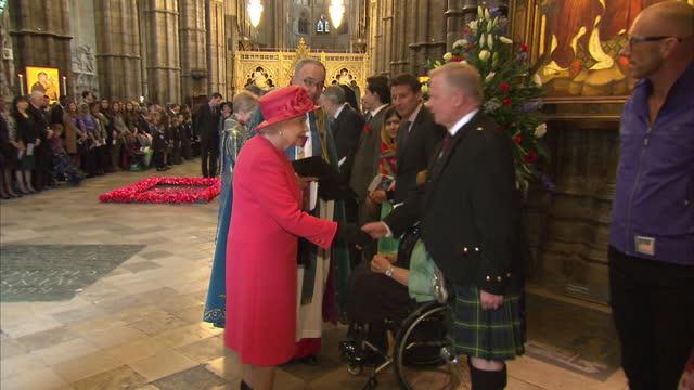 vídeos de stock, filmes e b-roll de interior shots the queen meeting malala yousafzai, lord sebastian coe & tanni grey thompson on march 10, 2014 in london, england. - sebastian coe