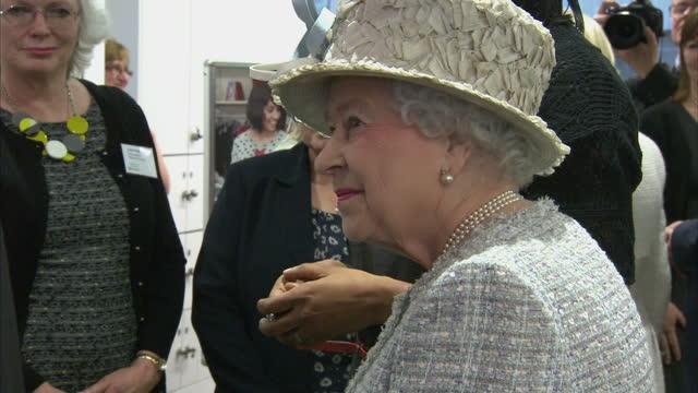 vídeos de stock, filmes e b-roll de interior shots the queen meeting workers shaking their hands. the queen meeting barnados workers on december 10, 2013 in ilford, england - ilford