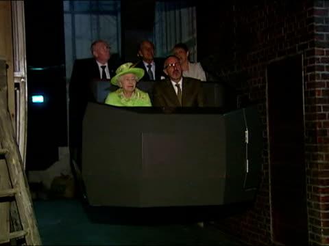 interior shots the queen & prince philip, duke of edinburgh sit in the titanic museum's shipyard as it travels through the exhibit queen elizabeth ii... - titanic belfast stock videos & royalty-free footage