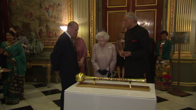 Interior shots the Queen Prince Philip looking over sceptre on table representing the Commonwealth on March 10 2014 in London England