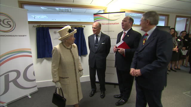 Interior shots the Queen Prince Philip pulling curtains unveiling plaque on March 12 2014 in London England