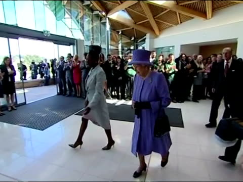 interior shots the queen university of exeter chancellor floella benjamin walk over to table the queen sits to sign the visitors book queen elizabeth... - floella benjamin stock videos & royalty-free footage