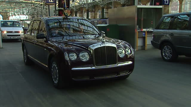interior shots the royal train pulls into glasgow central station, lord provost sadie docherty greets the queen and prince philip as they step off... - commonwealth games stock videos & royalty-free footage