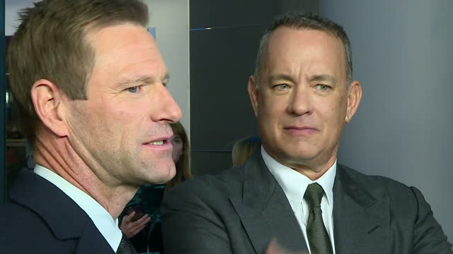 Interior shots Tom Hanks actor and Aaron Eckhart actor talking to media on red carpet of film 'Sully' based on the story of pilot Chesley...