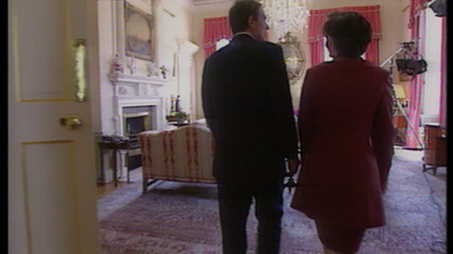 Interior shots Tony Blair Cherie Blair walking through 10 Downing St looking through rooms on May 2nd 1997 in London United Kingdom