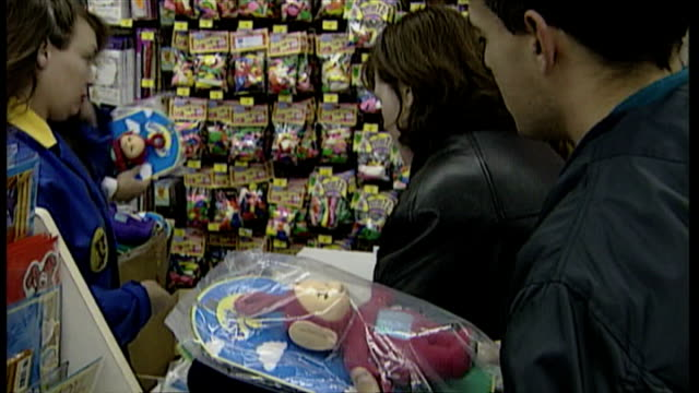 interior shots toys r us staff handing out teletubbies dolls, the 1997 christmas craze toy in exchange for 'one per customer' tickets. on november... - toys r us stock videos & royalty-free footage