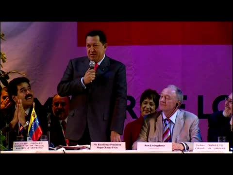 interior shots venezuelan president hugo chavez addresses supporters at the camden centre for 'hands off venezuela' event hosted by london mayor ken... - ウゴ・チャベス点の映像素材/bロール