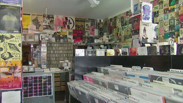 vídeos y material grabado en eventos de stock de interior shots vinyl records for sale in racks displayed on walls in independent record store on march 31 2015 in london united kingdom - tienda de discos