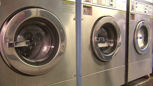 interior shots washing machines running in launderette with soapy water and washing spinning inside machines on january 26 2016 in worcester england - laundromat stock videos & royalty-free footage
