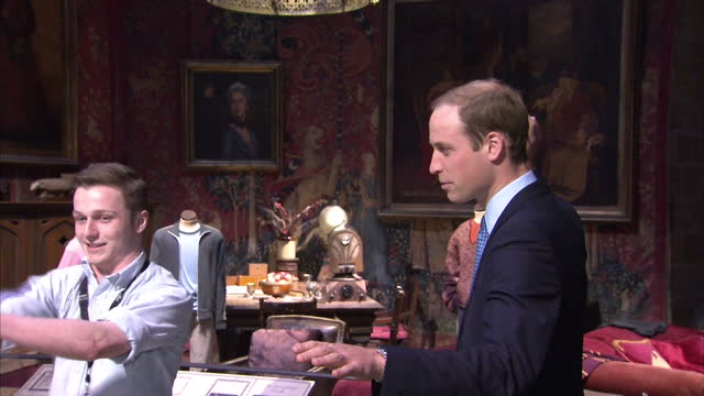 interior shots william and catherine being shown harry potter wand skills. the duke and duchess of cambridge and prince harry attend the inauguration... - harry potter titolo d'opera famosa video stock e b–roll