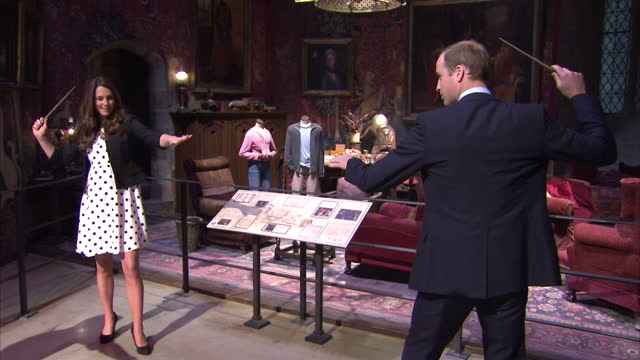 interior shots william and catherine have a duel with harry potter wands. the duke and duchess of cambridge and prince harry attend the inauguration... - harry potter titolo d'opera famosa video stock e b–roll