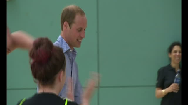 interior shots William Duke of Cambridge dribbling football during training drill beats other competitors and raises hands in celebrations