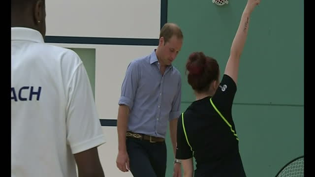interior shots William Duke of Cambridge joins in training session dribbling with football during coaching drill