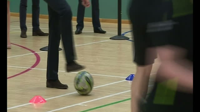 interior shots William Duke of Cambridge performs football training drill has the ball tackled from him multiple times