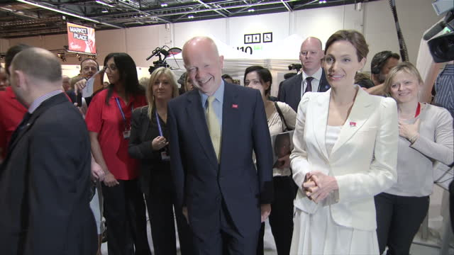 Interior shots William Hague Foreign Secretary and Angelina Jolie actress and UN Envoy walking around Global Rape Summit at London's Excel centre on...