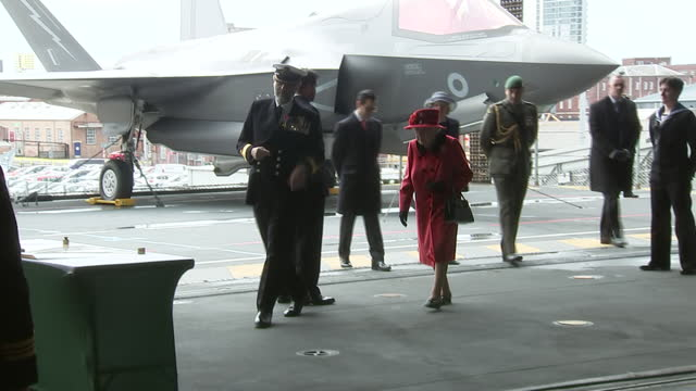 interior shots with officers and crew members of the hms queen elizabeth waiting for the queen to arrive on 22 may 2021, united kingdom - イングランド南東部点の映像素材/bロール
