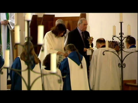interior shots women priests receiving holy communion eucharist at church altar - priest stock videos & royalty-free footage