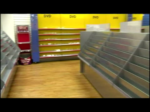 interior shots woolworths store with sale & liquidation signs hanging from ceiling, customers shopping. interior shots empty shelves. interior... - recession stock videos & royalty-free footage
