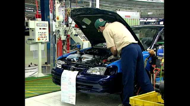 stockvideo's en b-roll-footage met interior shots workers in toyota car manufacturing factory assembling cars on production line on october 20 1997 in ontario canada - toyota motor