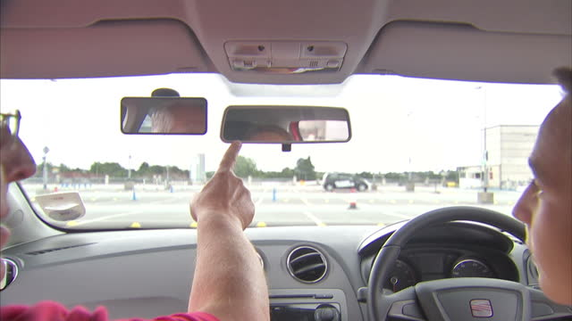 interior shots young learner driver under 17 years old receives lesson on safety and correct use of hand brake mirrors and pedals from driving... - driving test stock videos and b-roll footage